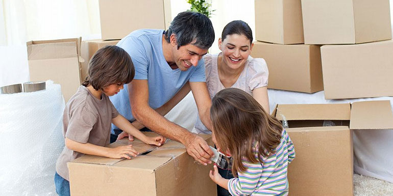 Family packing belongings for moving